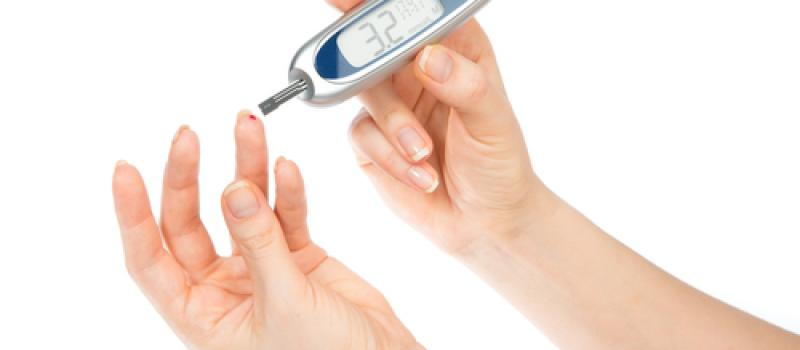 image of diabetic's glucose meter used to prick finger
